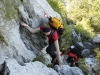 Via Dinarica team climbing difficult areas of the trail, secured by a metal cable, on their way to the peaks of Mosor mountain, Croatia.